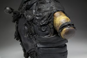 Ronald Gonzalez -  <strong>Hitch (detail)</strong> (2018<strong style = 'color:#635a27'></strong>)<bR /> black leather, found objects, wire, wax, carbon, screws and metal filings over welded steel armatures, 13 x 8 x 12 inches