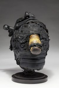 Ronald Gonzalez -  <strong>Hitch </strong> (2018<strong style = 'color:#635a27'></strong>)<bR /> black leather, found objects, wire, wax, carbon, screws and metal filings over welded steel armatures, 13 x 8 x 12 inches