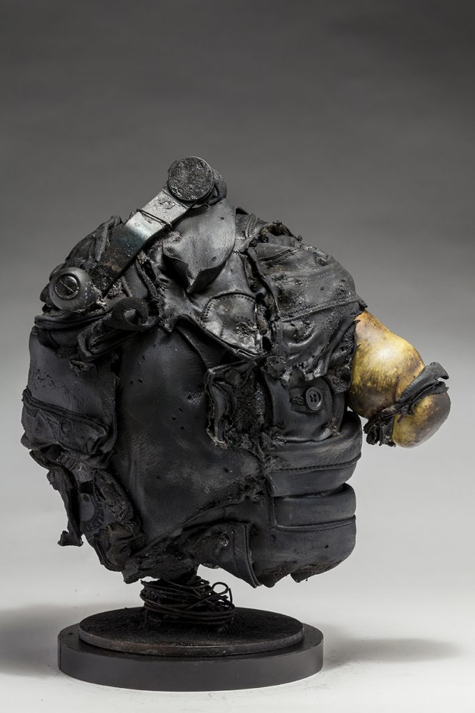 Ronald Gonzalez -  <strong>Hitch (side)</strong> (2018<strong style = 'color:#635a27'></strong>)<bR /> black leather, found objects, wire, wax, carbon, screws and metal filings over welded steel armatures, 13 x 8 x 12 inches