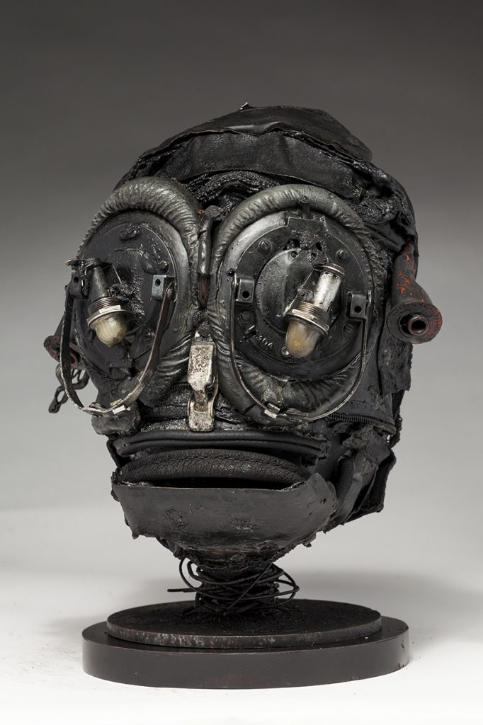 Ronald Gonzalez -  <strong>Insect (side)</strong> (2018<strong style = 'color:#635a27'></strong>)<bR /> black leather, found objects, wire, wax, carbon, screws and metal filings over welded steel armatures, 11 x 8 x 8 inches