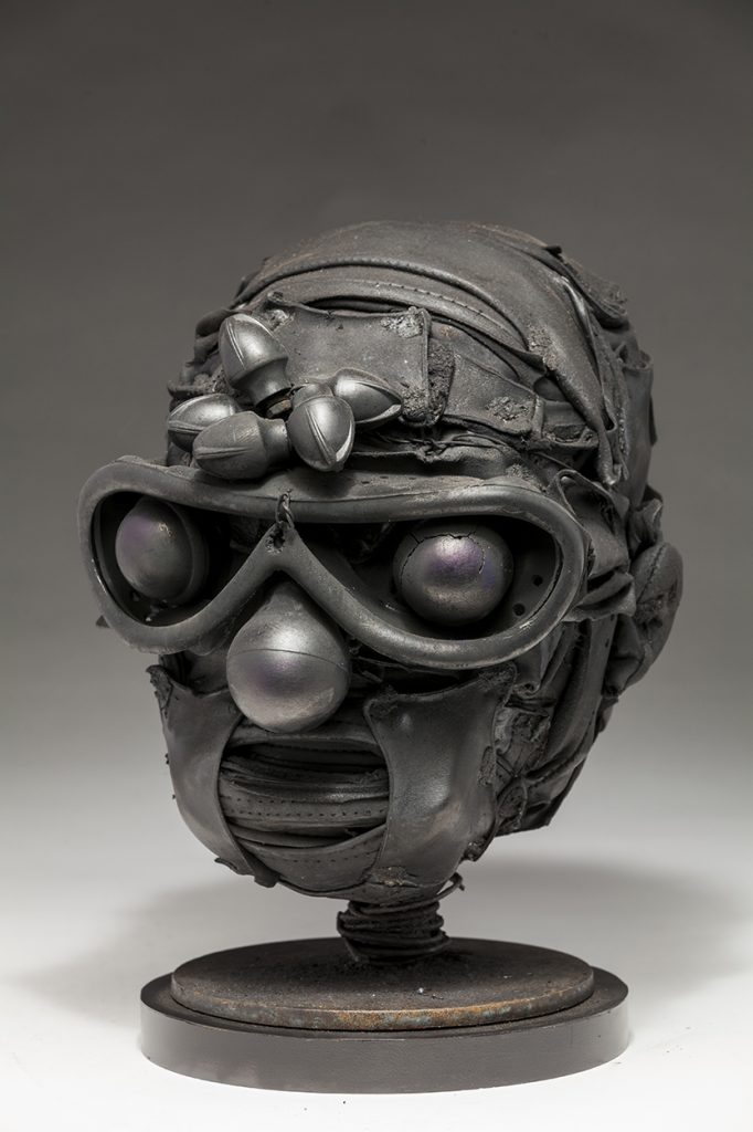 Ronald Gonzalez -  <strong>Knobs</strong> (2018<strong style = 'color:#635a27'></strong>)<bR /> black leather, found objects, wire, wax, carbon, screws and metal filings over welded steel armatures, 11 x 9 x 9 inches