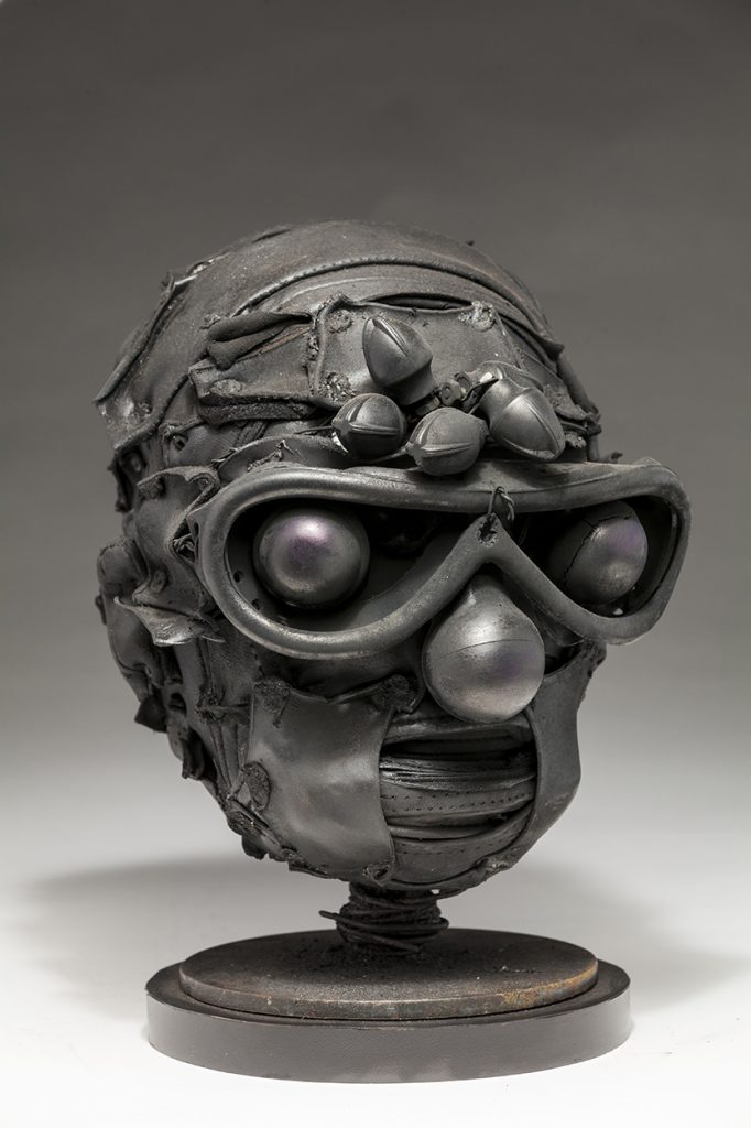 Ronald Gonzalez -  <strong>Knobs (side)</strong> (2018<strong style = 'color:#635a27'></strong>)<bR /> black leather, found objects, wire, wax, carbon, screws and metal filings over welded steel armatures, 11 x 9 x 9 inches