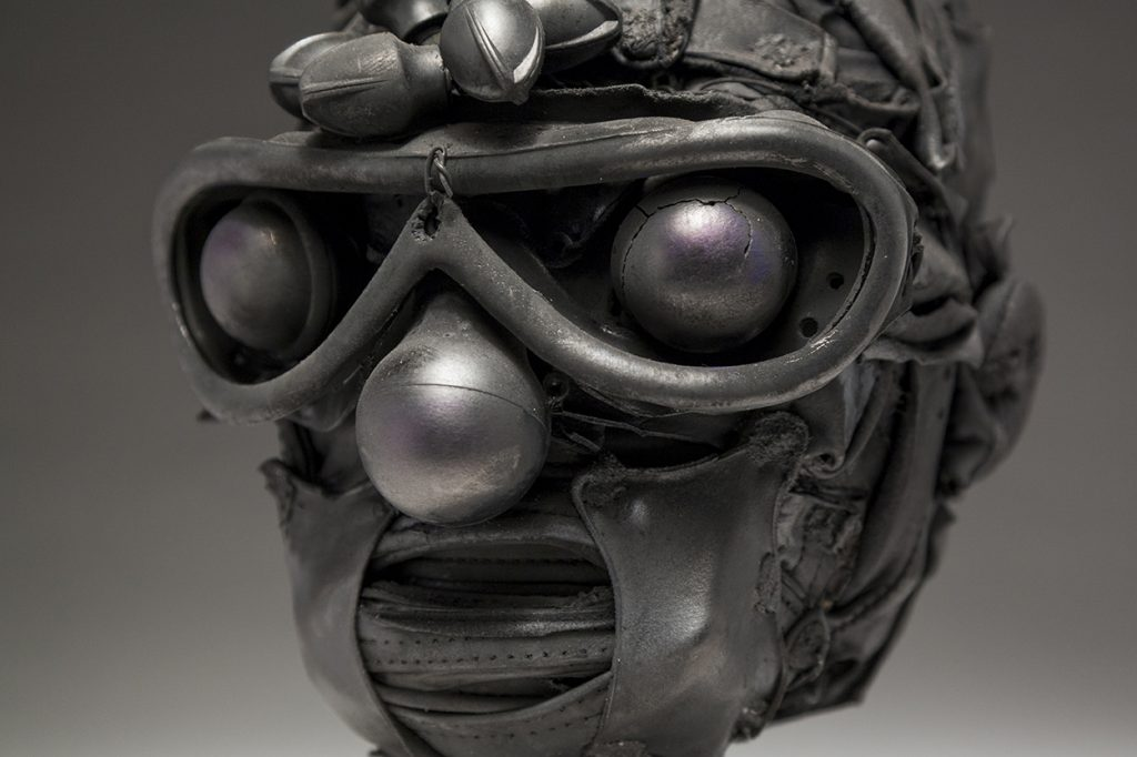 Ronald Gonzalez -  <strong>Knobs (detail)</strong> (2018<strong style = 'color:#635a27'></strong>)<bR /> black leather, found objects, wire, wax, carbon, screws and metal filings over welded steel armatures, 11 x 9 x 9 inches