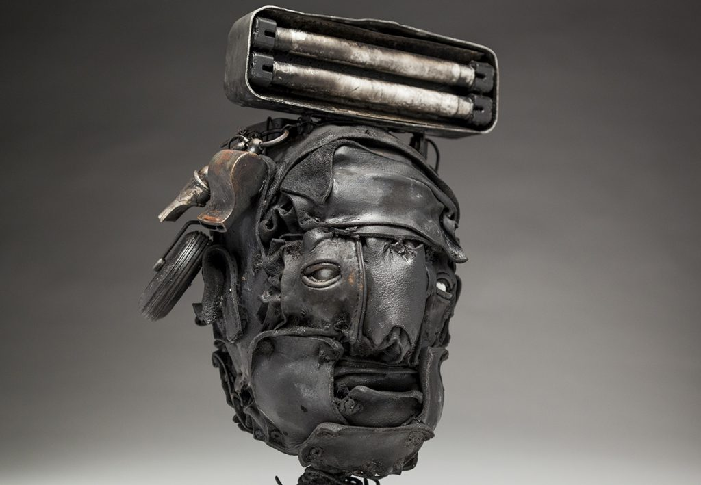 Ronald Gonzalez -  <strong>Lamp (detail)</strong> (2018<strong style = 'color:#635a27'></strong>)<bR /> black leather, found objects, wire, wax, carbon, screws and metal filings over welded steel armatures, 13 x 8 x 7 inches