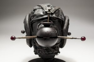 Ronald Gonzalez -  <strong>Messenger (detail)</strong> (2018<strong style = 'color:#635a27'></strong>)<bR /> black leather, found objects, wire, wax, carbon, screws and metal filings over welded steel armatures, 11 x 9 x 12 inches