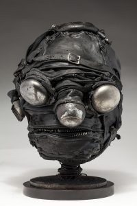 Ronald Gonzalez -  <strong>Mirrors</strong> (2018<strong style = 'color:#635a27'></strong>)<bR /> black leather, found objects, wire, wax, carbon, screws and metal filings over welded steel armatures, 13 x 9 x 10 inches