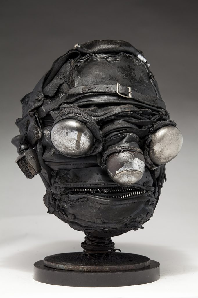Ronald Gonzalez -  <strong>Mirrors (side)</strong> (2018<strong style = 'color:#635a27'></strong>)<bR /> black leather, found objects, wire, wax, carbon, screws and metal filings over welded steel armatures, 13 x 9 x 10 inches