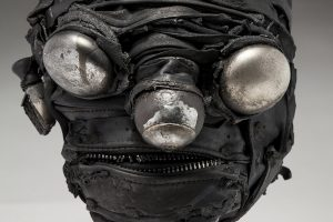 Ronald Gonzalez -  <strong>Mirrors (detail)</strong> (2018<strong style = 'color:#635a27'></strong>)<bR /> black leather, found objects, wire, wax, carbon, screws and metal filings over welded steel armatures, 13 x 9 x 10 inches