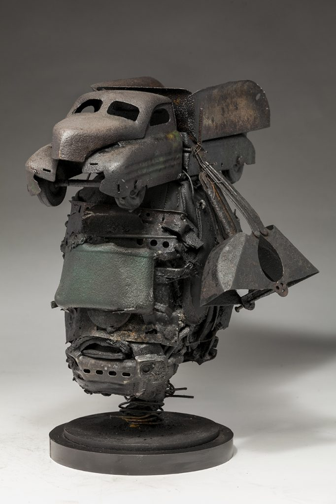 Ronald Gonzalez -  <strong>Mortal</strong> (2018<strong style = 'color:#635a27'></strong>)<bR /> black leather, found objects, wire, wax, carbon, screws and metal filings over welded steel armatures, 14 x 9 x 12 inches