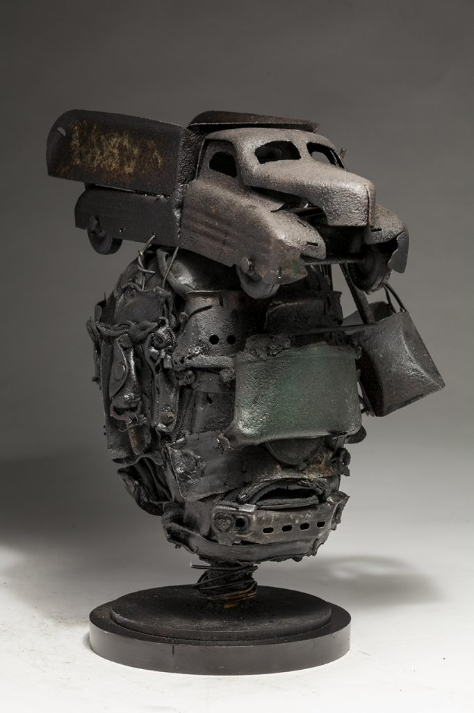 Ronald Gonzalez -  <strong>Mortal (side)</strong> (2018<strong style = 'color:#635a27'></strong>)<bR /> black leather, found objects, wire, wax, carbon, screws and metal filings over welded steel armatures, 14 x 9 x 12 inches
