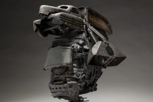Ronald Gonzalez -  <strong>Mortal (detail)</strong> (2018<strong style = 'color:#635a27'></strong>)<bR /> black leather, found objects, wire, wax, carbon, screws and metal filings over welded steel armatures, 14 x 9 x 12 inches