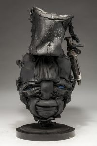 Ronald Gonzalez -  <strong>Open To Pain</strong> (2018<strong style = 'color:#635a27'></strong>)<bR /> black leather, found objects, wire, wax, carbon, screws and metal filings over welded steel armatures, 15 x 9 x 8 inches