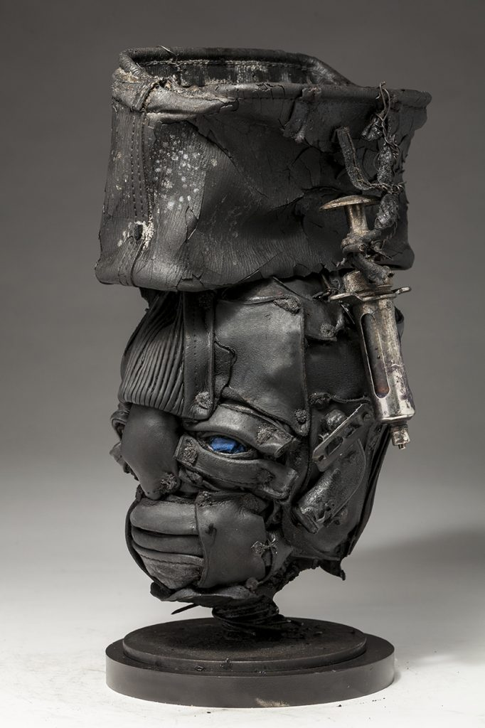 Ronald Gonzalez -  <strong>Open To Pain (side)</strong> (2018<strong style = 'color:#635a27'></strong>)<bR /> black leather, found objects, wire, wax, carbon, screws and metal filings over welded steel armatures, 15 x 9 x 8 inches
