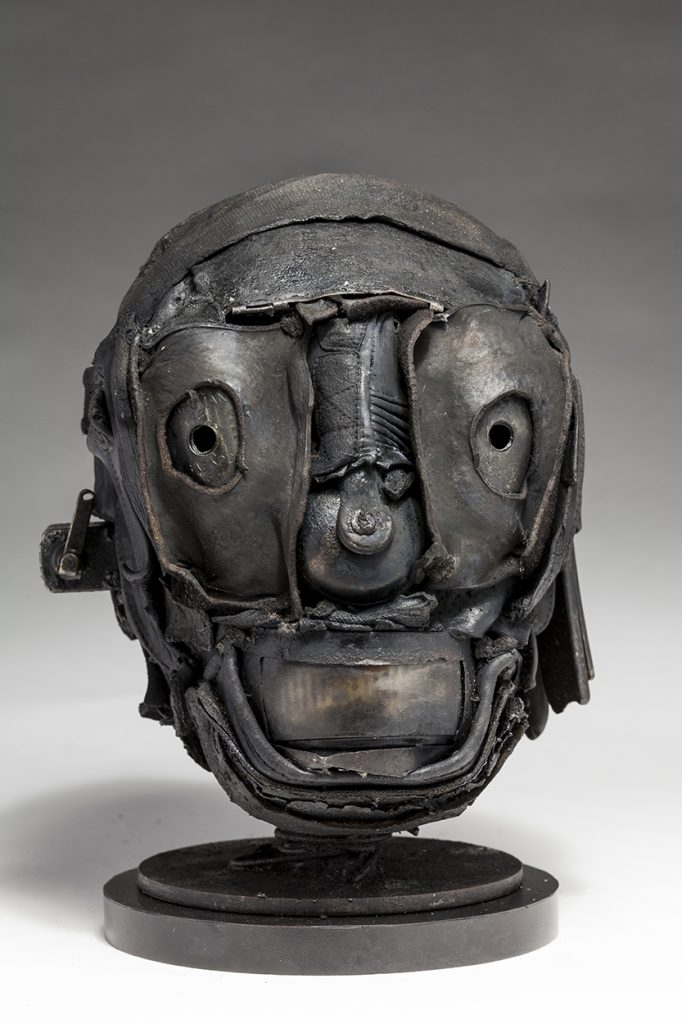 Ronald Gonzalez -  <strong>Skull</strong> (2018<strong style = 'color:#635a27'></strong>)<bR /> black leather, found objects, wire, wax, carbon, screws and metal filings over welded steel armatures,  11 x 7 x 9 inches