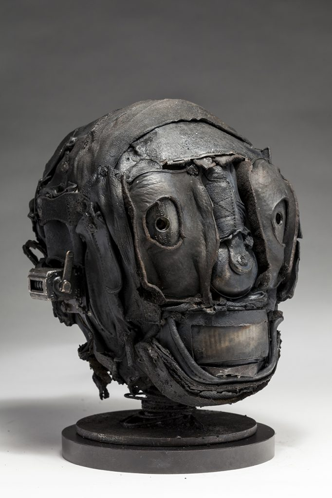 Ronald Gonzalez -  <strong>Skull (side)</strong> (2018<strong style = 'color:#635a27'></strong>)<bR /> black leather, found objects, wire, wax, carbon, screws and metal filings over welded steel armatures,  11 x 7 x 9 inches