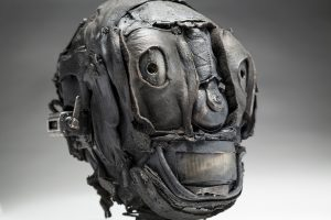 Ronald Gonzalez -  <strong>Skull (detail)</strong> (2018<strong style = 'color:#635a27'></strong>)<bR /> black leather, found objects, wire, wax, carbon, screws and metal filings over welded steel armatures,  11 x 7 x 9 inches
