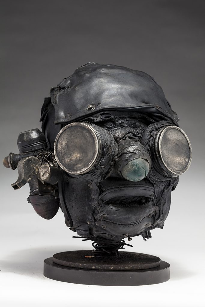 Ronald Gonzalez -  <strong>Searchlights (side)</strong> (2018<strong style = 'color:#635a27'></strong>)<bR /> black leather, found objects, wire, wax, carbon, screws and metal filings over welded steel armatures, 11 x 9 x 10 inches