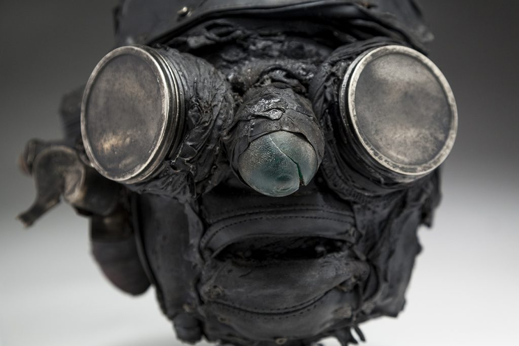 Ronald Gonzalez -  <strong>Searchlights (detail)</strong> (2018<strong style = 'color:#635a27'></strong>)<bR /> black leather, found objects, wire, wax, carbon, screws and metal filings over welded steel armatures, 11 x 9 x 10 inches