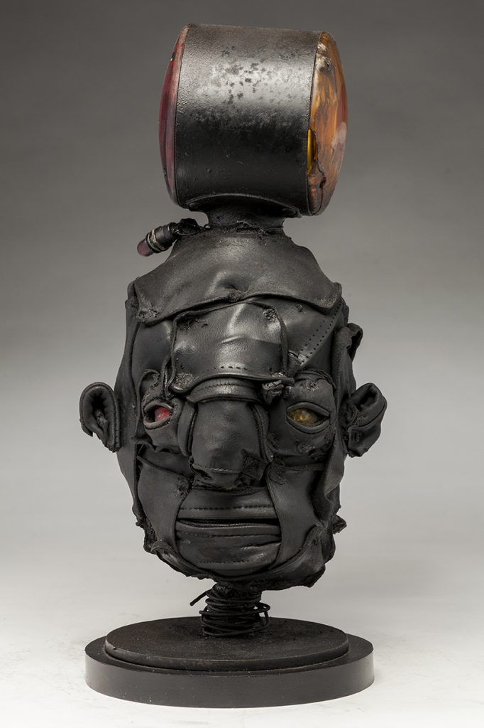 Ronald Gonzalez -  <strong>Signal</strong> (2018<strong style = 'color:#635a27'></strong>)<bR /> black leather, found objects, wire, wax, carbon, screws and metal filings over welded steel armatures, 16 x 7 x 8 inches
