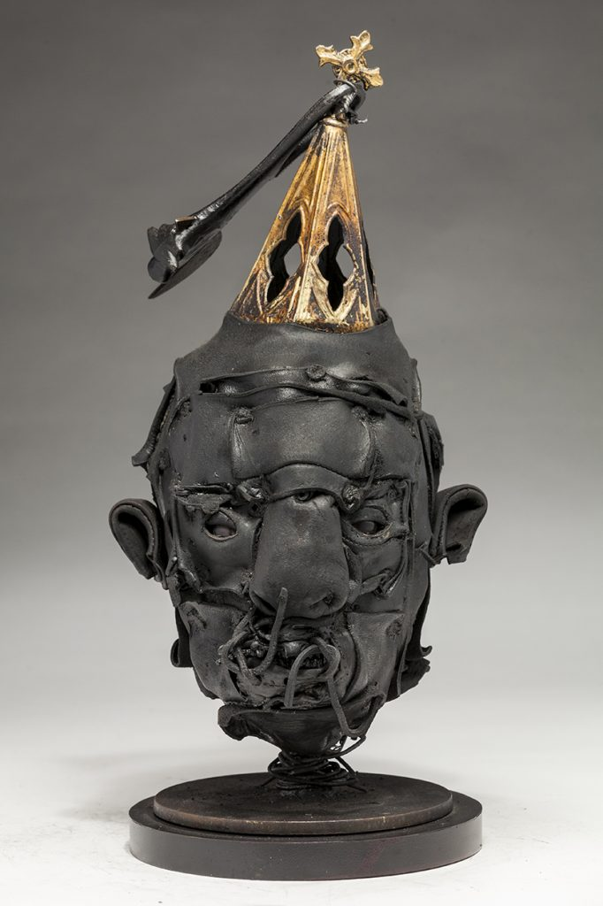 Ronald Gonzalez -  <strong>Steeple</strong> (2018<strong style = 'color:#635a27'></strong>)<bR /> black leather, found objects, wire, wax, carbon, screws and metal filings over welded steel armatures, 16 x 8 x 8 inches