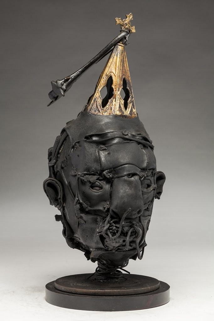 Ronald Gonzalez -  <strong>Steeple (side)</strong> (2018<strong style = 'color:#635a27'></strong>)<bR /> black leather, found objects, wire, wax, carbon, screws and metal filings over welded steel armatures, 16 x 8 x 8 inches