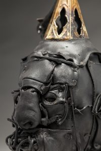 Ronald Gonzalez -  <strong>Steeple (detail)</strong> (2018<strong style = 'color:#635a27'></strong>)<bR /> black leather, found objects, wire, wax, carbon, screws and metal filings over welded steel armatures, 16 x 8 x 8 inches