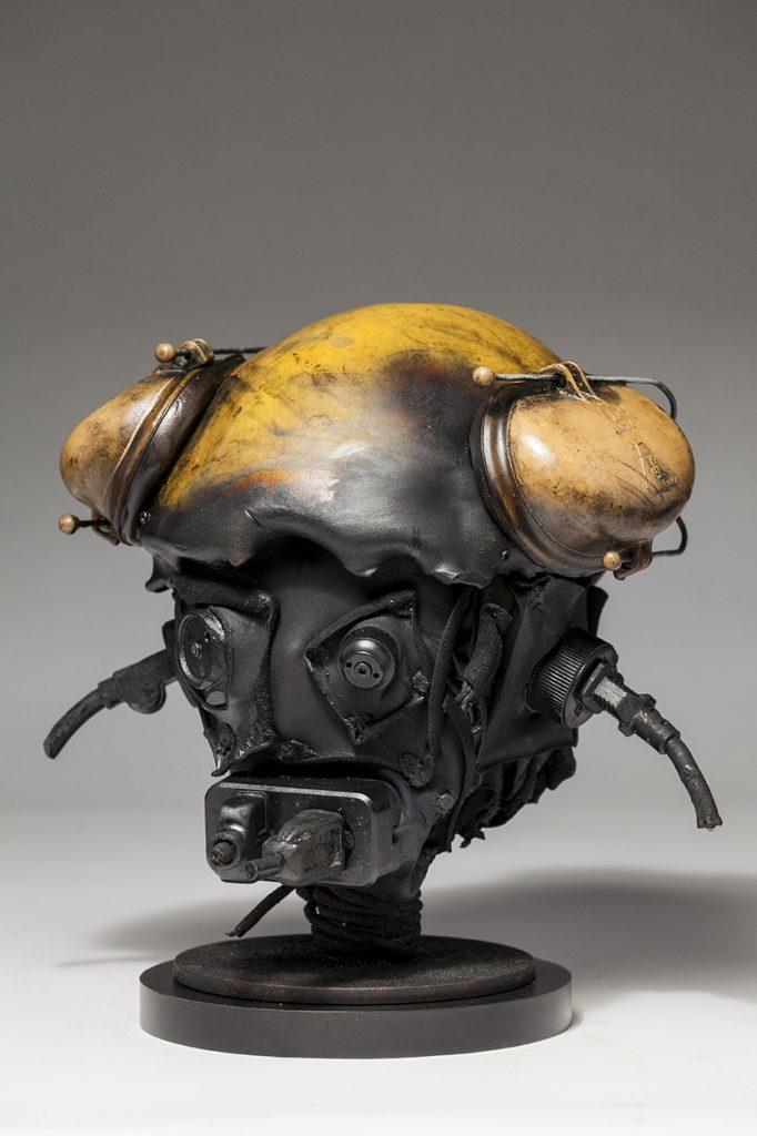 Ronald Gonzalez -  <strong>Suddenly Shocked (side)</strong> (2018<strong style = 'color:#635a27'></strong>)<bR /> black leather, found objects, wire, wax, carbon, screws and metal filings over welded steel armatures, 12 x 13 x 12 inches
