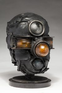 Ronald Gonzalez -  <strong>Third Eye</strong> (2018<strong style = 'color:#635a27'></strong>)<bR /> black leather, found objects, wire, wax, carbon, screws and metal filings over welded steel armatures, 12 x 8 x 11 inches