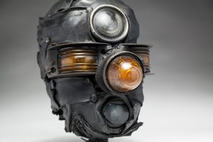 Ronald Gonzalez -  <strong>Third Eye (detail)</strong> (2018<strong style = 'color:#635a27'></strong>)<bR /> black leather, found objects, wire, wax, carbon, screws and metal filings over welded steel armatures, 12 x 8 x 11 inches