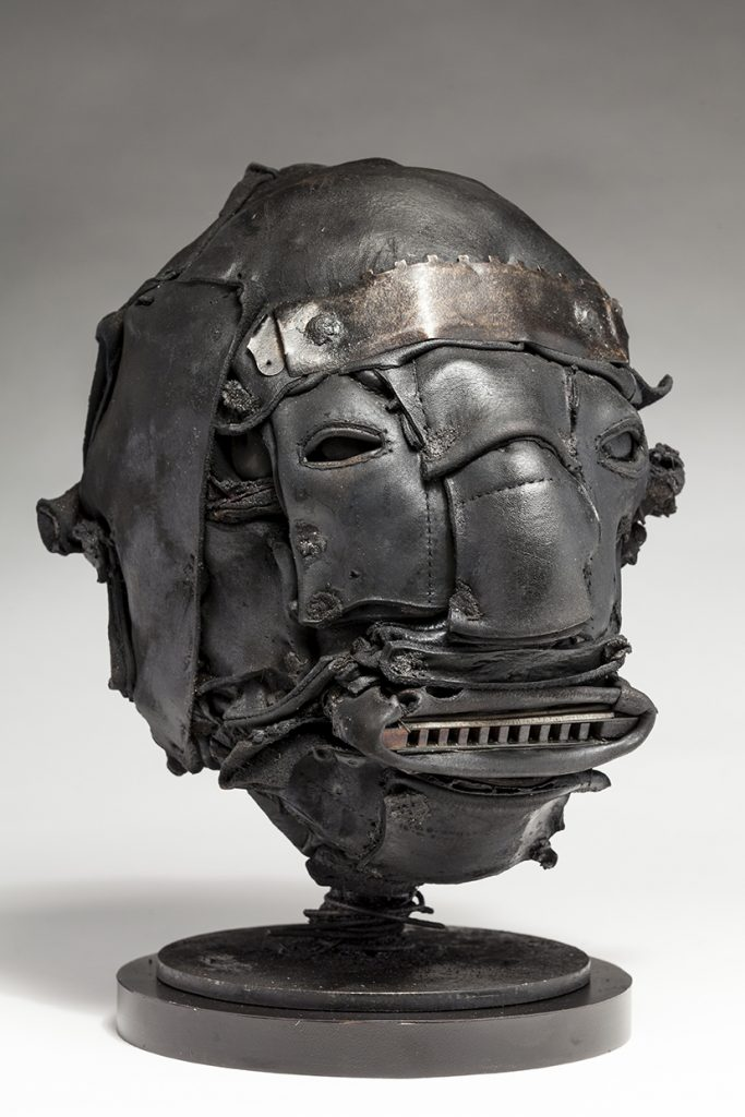 Ronald Gonzalez -  <strong>Tune (side)</strong> (2018<strong style = 'color:#635a27'></strong>)<bR /> black leather, found objects, wire, wax, carbon, screws and metal filings over welded steel armatures, 12 x 8 x 10 inches