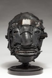 Ronald Gonzalez -  <strong>Tune</strong> (2018<strong style = 'color:#635a27'></strong>)<bR /> black leather, found objects, wire, wax, carbon, screws and metal filings over welded steel armatures, 12 x 8 x 10 inches