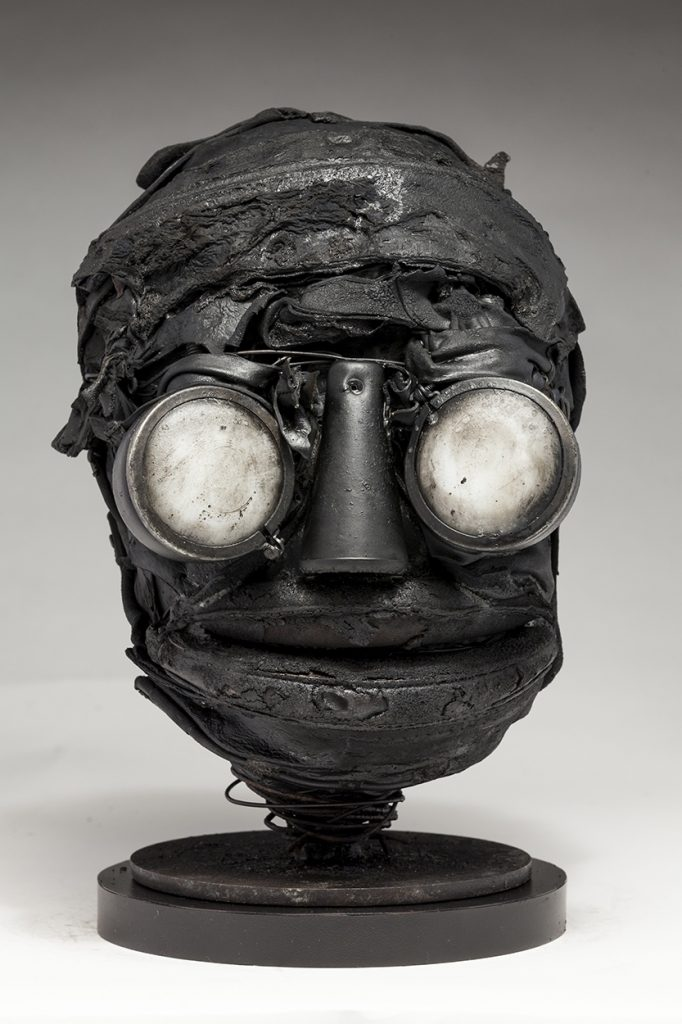 Ronald Gonzalez -  <strong>Whites</strong> (2018<strong style = 'color:#635a27'></strong>)<bR /> black leather, found objects, wire, wax, carbon, screws and metal filings over welded steel armatures, 11 x 7 x 8 inches