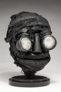Ronald Gonzalez -  <strong>Whites (side)</strong> (2018<strong style = 'color:#635a27'></strong>)<bR /> black leather, found objects, wire, wax, carbon, screws and metal filings over welded steel armatures, 11 x 7 x 8 inches