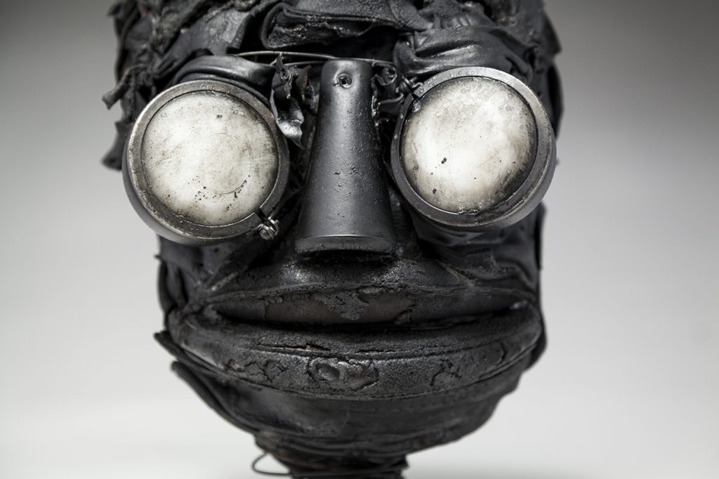 Ronald Gonzalez -  <strong>Whites (detail)</strong> (2018<strong style = 'color:#635a27'></strong>)<bR /> black leather, found objects, wire, wax, carbon, screws and metal filings over welded steel armatures, 11 x 7 x 8 inches