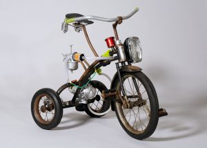 "Bradley Ehrsam -  <strong>H.G.</strong> (2019<strong style = 'color:#635a27'></strong>)<bR /> metal, reclaimed objects and hand blown glass  32""L x 26.75""W x 18""H  $14,000"